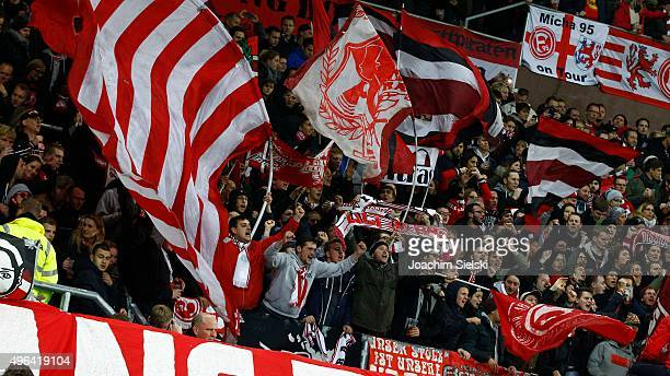 The Fans of Duesseldorf cheer during the Second Bundesliga match between FC St Pauli and Fortuna Duesseldorf at Millerntor Stadium on November 9 2015...