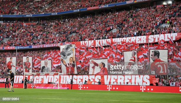 The fans of FC Bayern Muenchen celebrate Philipp Lahm of FC Bayern Muenchen during the Bundesliga match between Bayern Muenchen and SC Freiburg at...