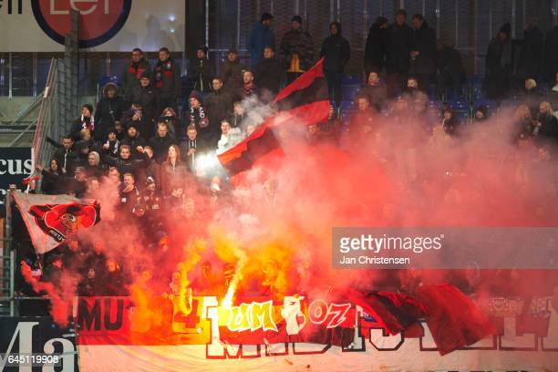 The fans of FC Midtjylland use pyro techniques during the Danish Alka Superliga match between Randers FC and FC Midtjylland at BioNutria Park Randers...