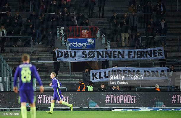 The fans of FC Midtjylland with a tifo against the club during the Danish Alka Superliga match between Brondby IF and FC Midtjylland at Brondby...