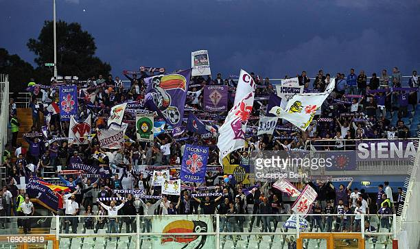 The fans of Fiorentina during the Serie A match between Pescara and ACF Fiorentina at Adriatico Stadium on May 19 2013 in Pescara Italy