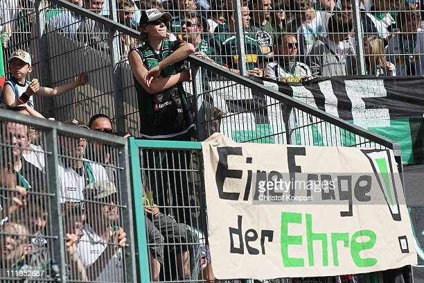 The fans of Gladbach show a banner during the Bundesliga match between Borussia Moenchengladbach and 1 FC Koeln at Borussia Park on April 10 2011 in...