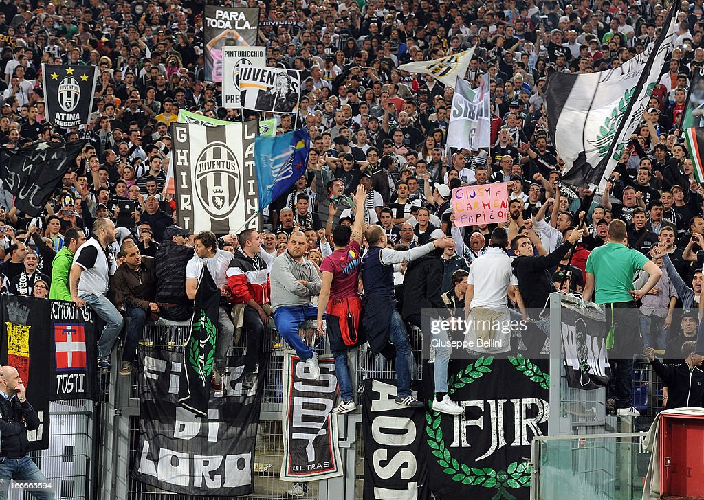 The fans of Juventus wave banners during the Serie A match between S.S. Lazio and Juventus at Stadio Olimpico on April 15, 2013 in Rome, Italy.