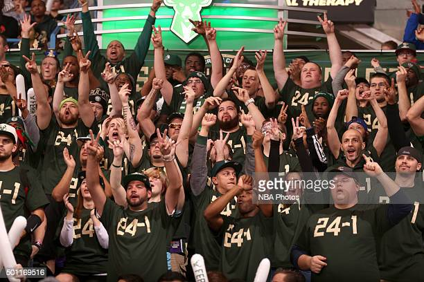 The fans of Milwaukee Bucks cheer them on during the game against the Golden State Warriors on December 12 2015 at the BMO Harris Bradley Center in...