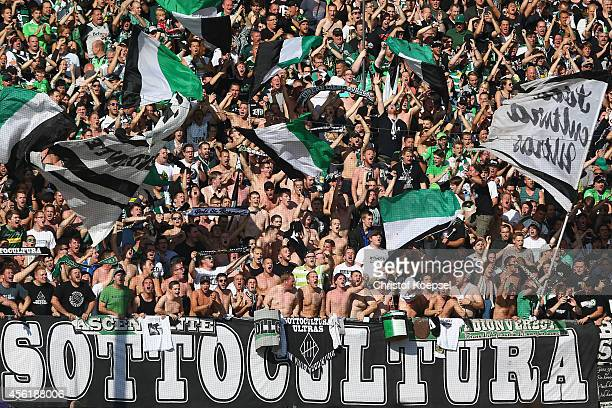 The fans of Moenchengladbach celebrate the first goal during the Bundesliga match between SC Paderborn and Borussia Moenchengladbach at Benteler...