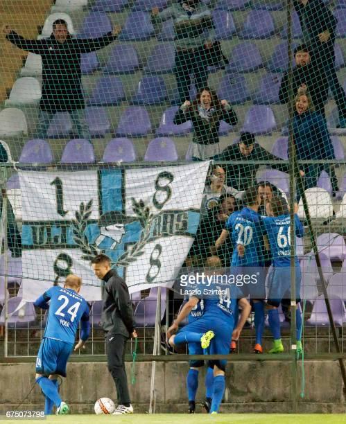 The fans of MTK Budapest celebrate the winning goal with goal scorer Adam Hrepka of MTK Budapest during the Hungarian OTP Bank Liga match between...