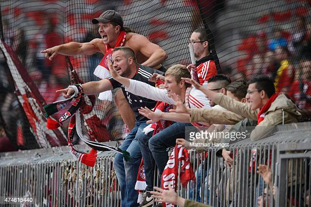 The fans of Muenchen celebrate after winning the league during the Bundesliga match between FC Bayern Muenchen and 1 FSV Mainz 05 at Allianz Arena on...
