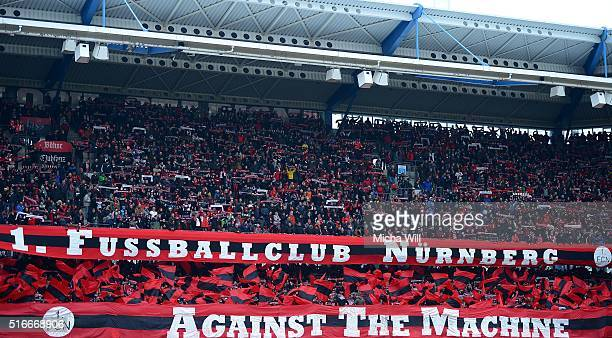 The fans of Nuernberg show a choreography at the beginning of the Second Bundesliga match between 1 FC Nuernberg and RB Leipzig at GrundigStadion on...