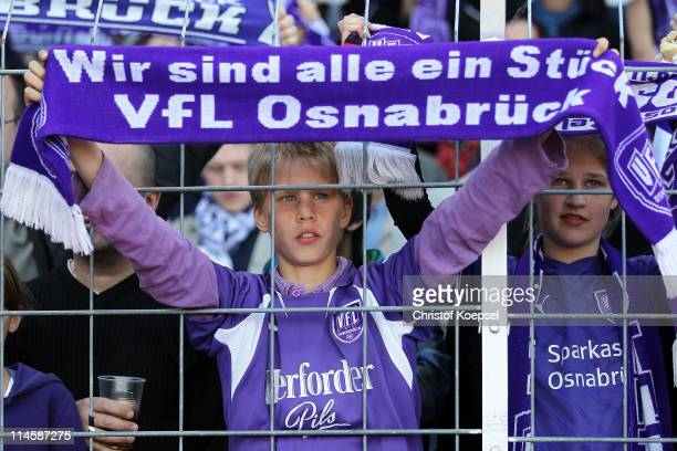 The fans of Osnabrueck celebrate their team during the Second Bundesliga playoff second leg match between Dynamo Dresden and VfL Osnabrueck at...