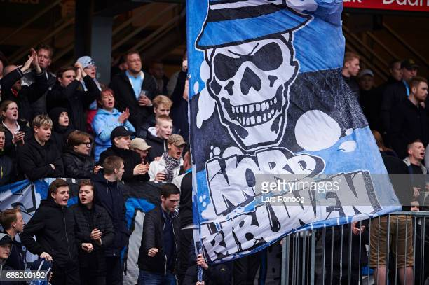 The fans of Randers FC cheer with flags during the Danish Cup DBU Pokalen quarterfinal match between Randers FC and Brondby IF at BioNutria Park on...