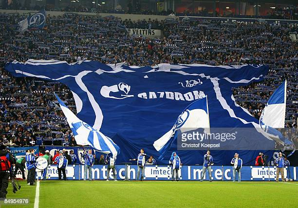 The fans of Schalke present a big jersey before the Bundesliga match between FC Schalke 04 and Borussia Dortmund at the VeltinsArena on February 20...