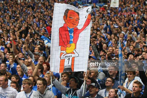 The fans of Schalke show a banner against Manuel Neuer of Bayern prior to the Bundesliga match between FC Schalke 04 and FC Bayern Muenchen at...
