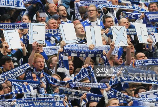 The fans of Schalke show banner during the Bundesliga match between FC Schalke 04 and Eintracht Frankfurt at Veltins Arena on March 12 2011 in...
