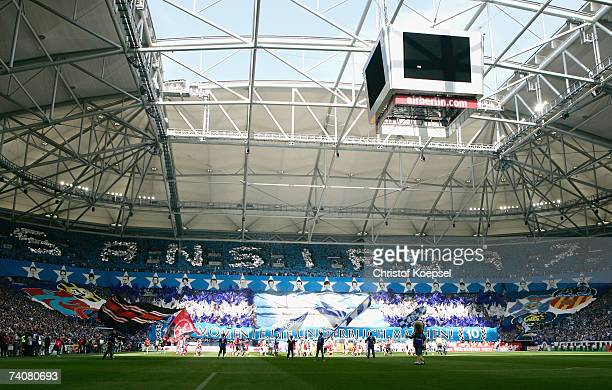 The fans of Schalke show banners before the Bundesliga match between Schalke 04 and 1FC Nuremberg at the Veltins Arena on May 5 2007 in Gelsenkirchen...