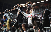 The fans of St Pauli celebrate at the end of the second Bundesliga match between FC St Pauli and Fortuna Duesseldorf at Millerntor Stadium on April 6...