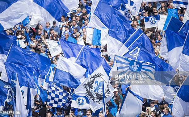 The fans of SV Darmstadt 98 wave flags during the first bundesliga match between SV Darmstadt 98 and Borussia Moenchengladbach at MerckStadion am...