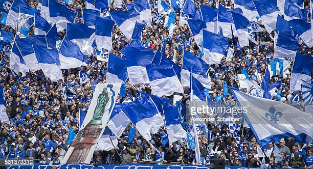 The fans of SV Darmstadt wave flags during the first bundesliga match between SV Darmstadt 98 and Borussia Moenchengladbach at MerckStadion am...
