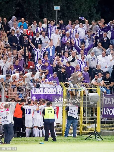 The fans of Ujpest FC celebrate the winning goal with the players of Ujpest FC during the Hungarian OTP Bank Liga match between Vasas FC and Ujpest...