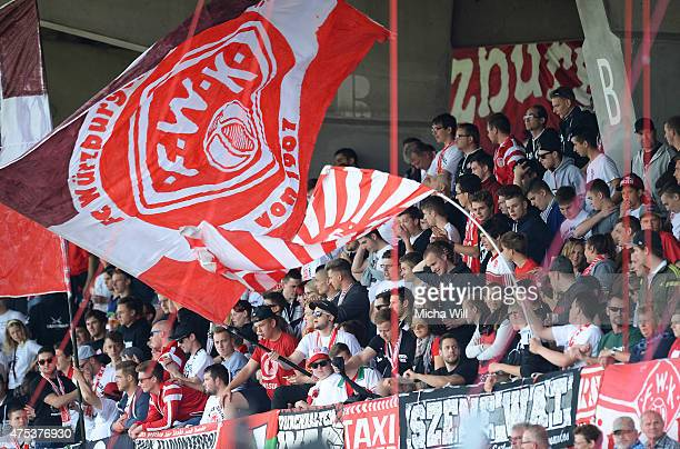 The fans of Wuerzburg cheer for their team during the Regionalliga Playoffs match between Wuerzburger Kickers and 1 FC Saarbruecken at flyeralarm...