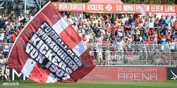 The fans of Wuerzburg cheer for their team during the Third League mtch between Wuerzburger Kickers and Erzgebirge Aue at flyeralarm Arena on August...