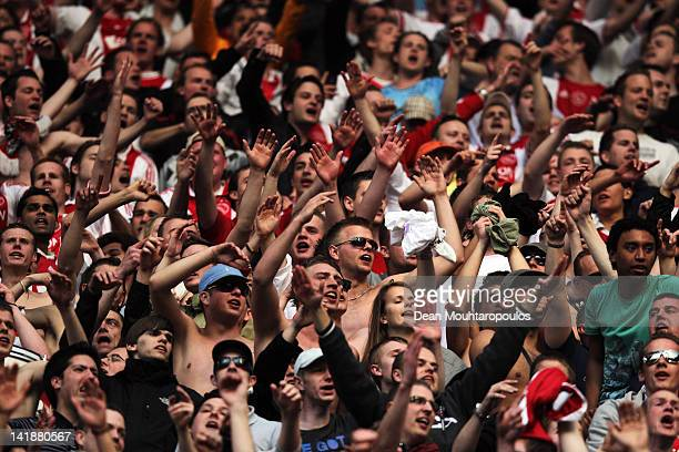 The fans sing and cheer after the Eredivisie match between Ajax Amsterdam and PSV Eindhoven at Amsterdam Arena on March 25 2012 in Amsterdam...