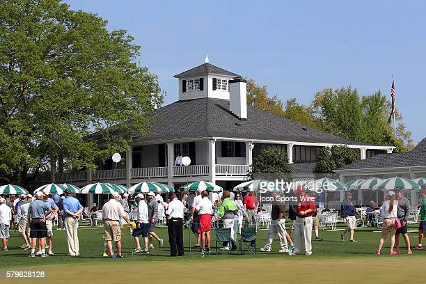 The fans wait to see their favorite golfers behind the clubhouse during the practice round for the 2015 Masters Tournament at the Augusta National...