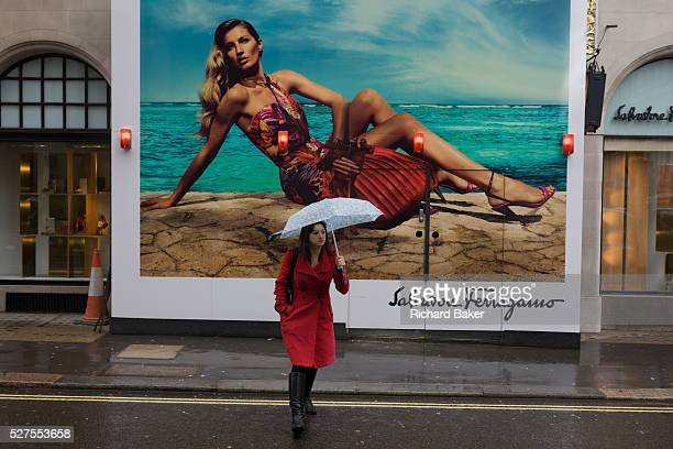 The fantasy of a model sunbathing on a beach is the opposite the experience of a local girl on a dark and rainy London on an April morning The...