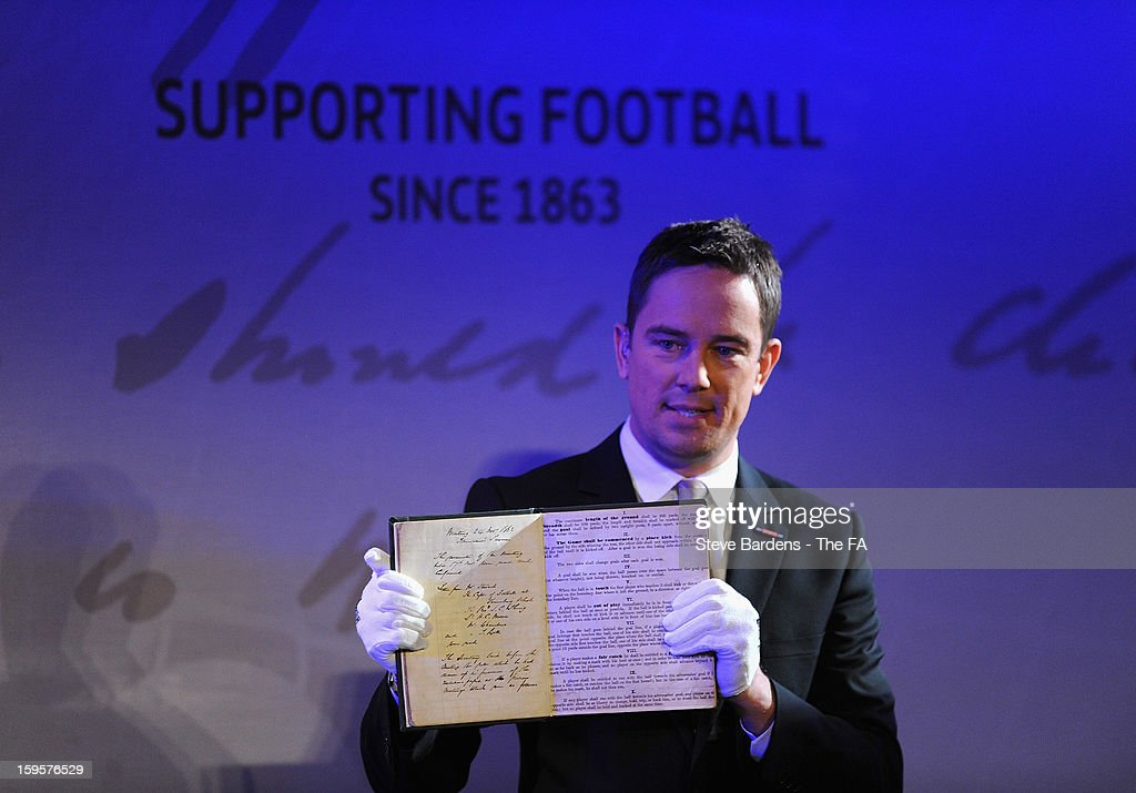 The FA's 1863 Minute Book is held by presenter Simon Thomas during the official launch to mark the FA's 150th Anniversary Year at the Grand Connaught Rooms on January 16, 2013 in London, England.