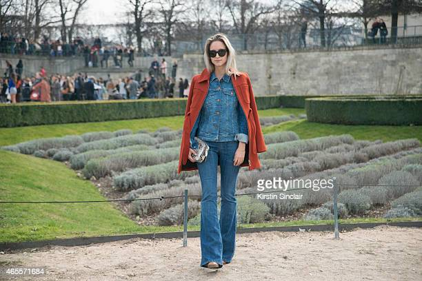 The Fashion Guitarâ writer Charlotte Groeneveld wears Topshop jacket H and M Trend jumpsuit Capretto bag and Valentino sunglasses on day 5 of Paris...