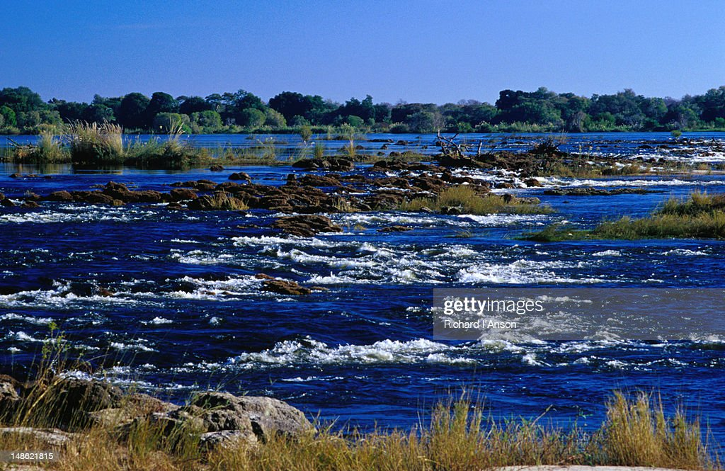 The fast flowing water of the Zambezi River upstream from Victoria Falls