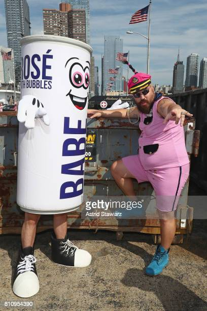 The Fat Jew poses with a mascot of Babe Rose with Bobbles at The PINK PARTY presented by SWISH at Pier 81 on July 8 2017 in New York City