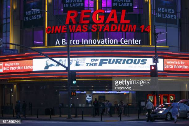 'The Fate of The Furious' signage is displayed outside the Regal Cinemas LA LIVE Stadium 14 movie theater in Los Angeles California US on Friday...