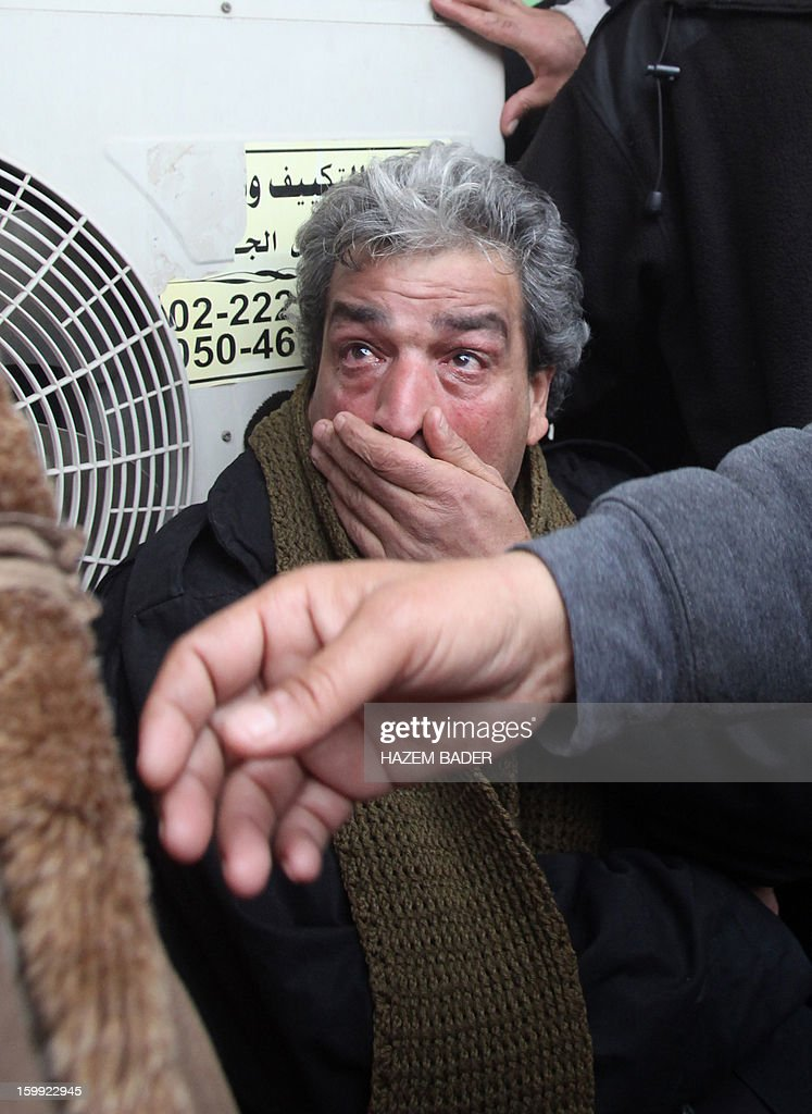 The father of 21-year-old Palestinian Lubna Hanash reacts after learning his daughter was killed , outside the al-Ahli hospital in the West bank town of Hebron on January 23, 2013. Lubna was killed by a bulleT on her face in a shooting outside a college near Al-Arrub refugee camp, some eight kilometres (five miles) north of Hebron, medics said. Witnesses told AFP a civilian car with Israeli plates stopped on the main Hebron-Bethlehem road and two men wearing military fatigues got out and began shooting towards a nearby Palestinian college.