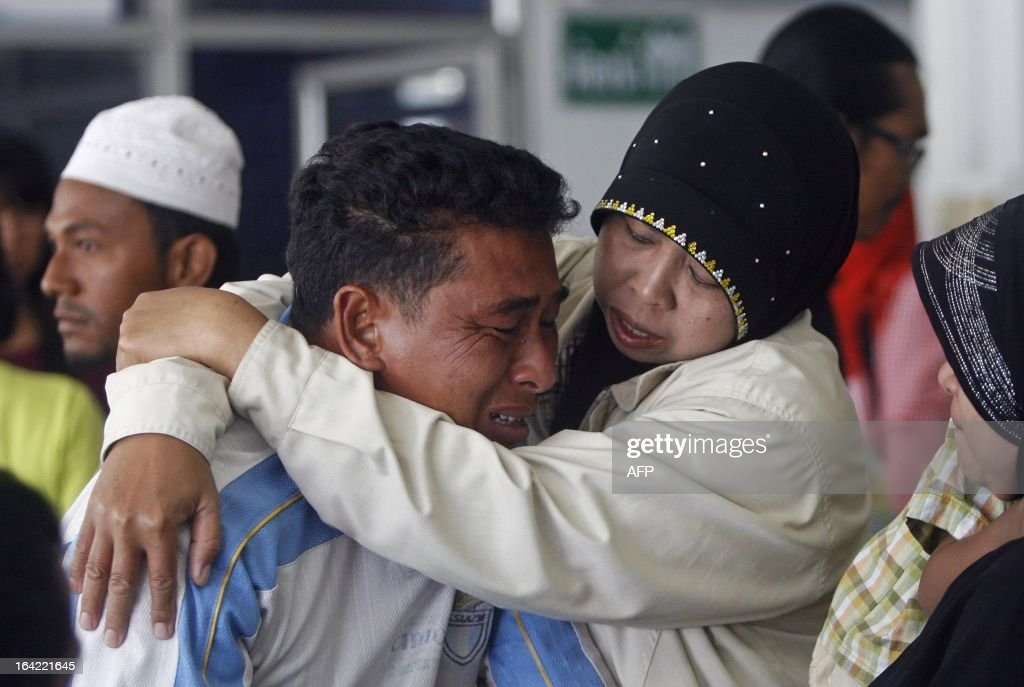 The father of a boy who was killed in a motorcycle bomb blast triggered by suspected separatist militants cries at a hospital in Thailand's restive southern province of Pattani on March 21, 2013. A stubborn insurgency seeking greater autonomy has raged across several provinces in the south of Thailand bordering Malaysia for nine years -- with near-daily shootings and bombings. AFP PHOTO/Tuwaedaniya MERINGING