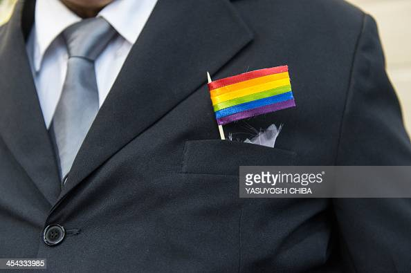 The father of a bride wears a rainbow flag during the wedding ceremony at the Court of Justice of the State of Rio de Janeiro in Rio de Janeiro...
