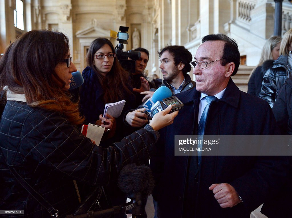 The father (R) of Fernando Trapero, a Guardia Civil officer who was killed in Capbreton in 2007, stands next to the press at Paris' courthouse as he attends the trial of three people thought to be members of the Basque separatist group ETA over the killing of Centeno and another Spanish civil guards, on April 2, 2013.