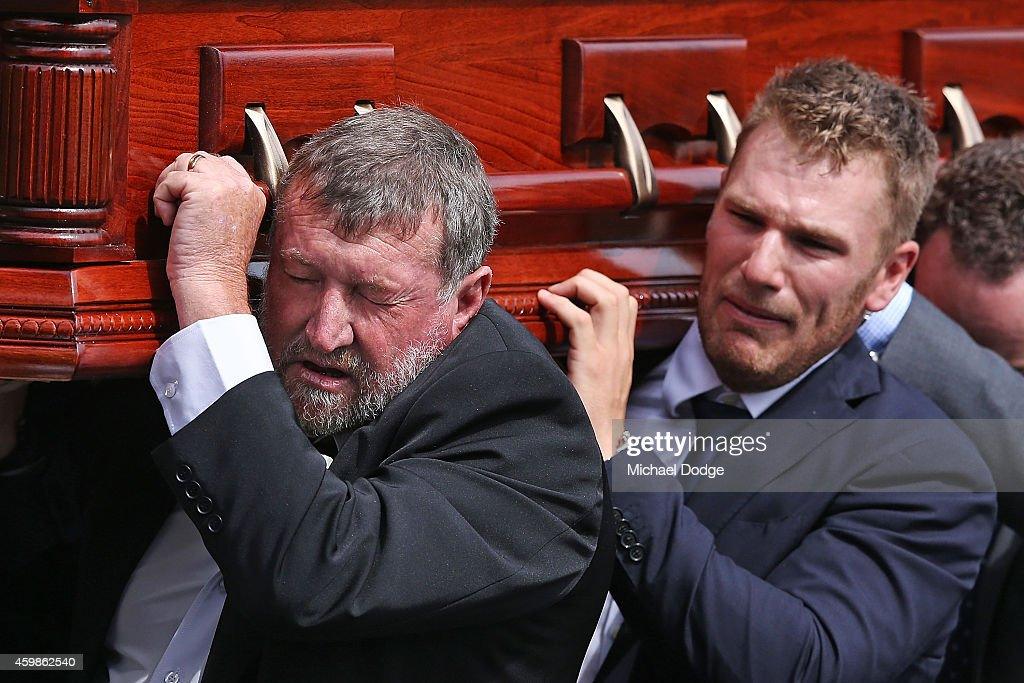 The father of Phillip Hughes, Gregory Hughes, carries the coffin with Australian cricket cricketer <a gi-track='captionPersonalityLinkClicked' href=/galleries/search?phrase=Aaron+Finch&family=editorial&specificpeople=724040 ng-click='$event.stopPropagation()'>Aaron Finch</a> (R) who cries during the Funeral Service for Phillip Hughes on December 3, 2014 in Macksville, Australia. Australian cricketer Phillip Hughes passed away last Thursday, aged 25, as a result of head injuries sustained during the Sheffield Shield match between South Australia and New South Wales at the SCG on Tuesday 25th November.