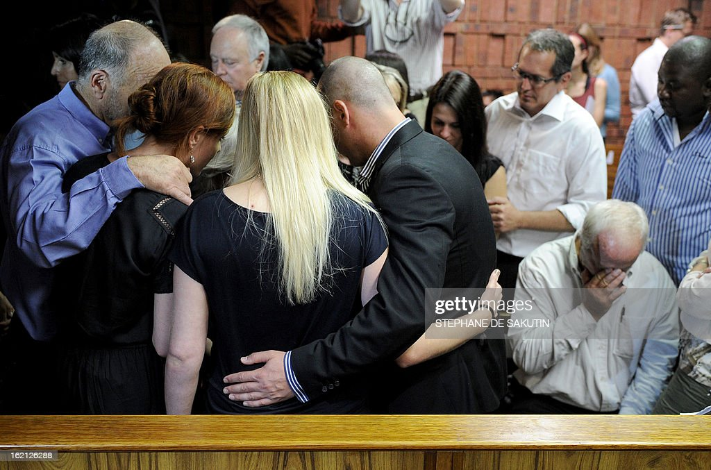 The father of South African Olympic sprinter Oscar Pistorius, Henke (R), reacts as relatives comfort each other on February 19, 2013 after his bail hearing was adjourned at the Magistrate Court in Pretoria to allow the prosecution time to study affidavits submitted by the defense. Pistorius is battling to secure bail as he appeared on charges of murdering his model girlfriend Reeva Steenkamp on February 14, Valentine's Day. South African prosecutors argued that Pistorius was guilty of premeditated murder in Steenkamp's death, a charge which could carry a life sentence.