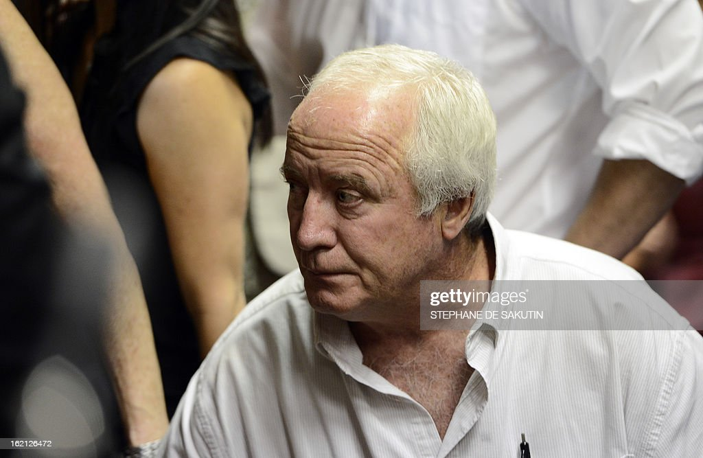 The father of South African Olympic sprinter Oscar Pistorius Henke reacts on February 19 2013 after his son's bail hearing was adjourned at the...