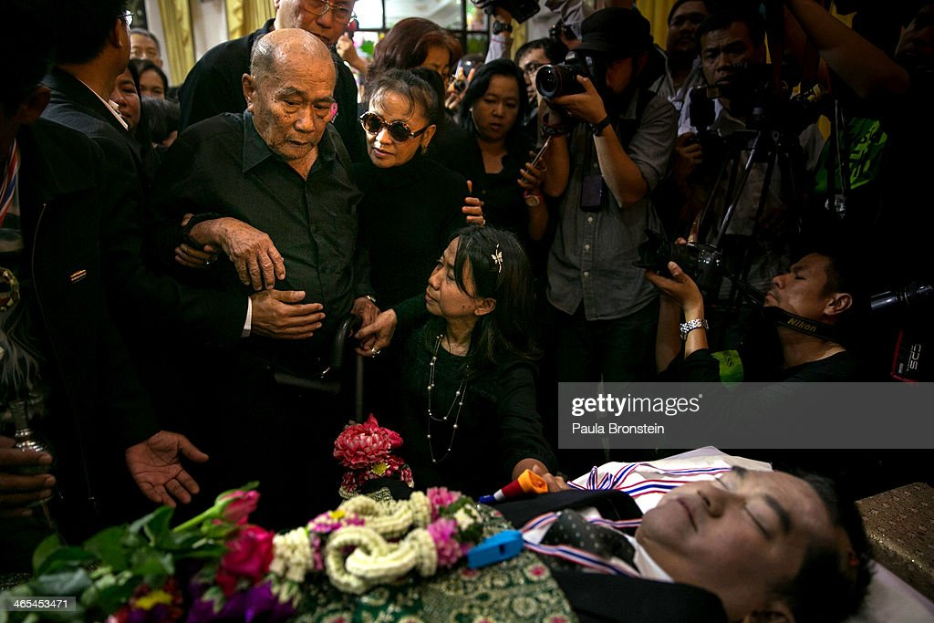 The father of Sutin Tharatin grieves at his funeral in Bangkok on January 27, 2014 in Bangkok, Thailand. Nine others were also injured during election related violence as protesters blocked polling stations as advanced voting took place in the capital city. Bangkok Shutdown has been in effect for two weeks as the anti-government protesters continue to block major intersections. The Thai government imposed a 60-day state of emergency in Bangkok and the surrounding provinces in an attempt to cope with the on-going political turmoil but so far this decree has had no effect on the mass protests.