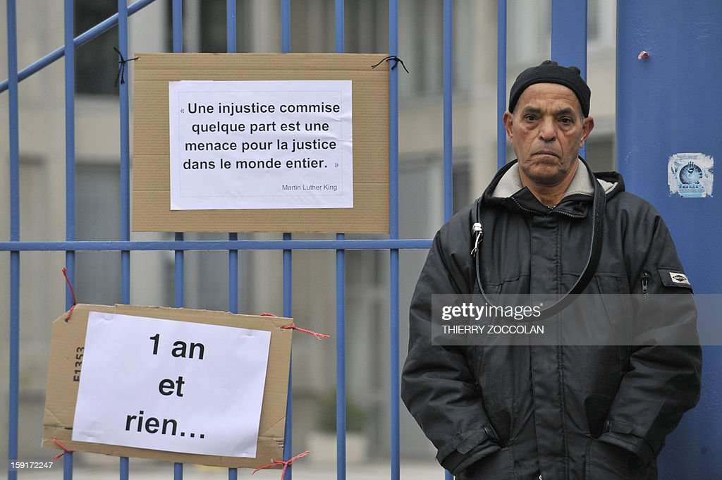 The father of Wissam El-Yamni, a young man who died following his arrest one year ago demonstrates in front of Clermont-Ferrand's courthouse, on January 1, 2013, to call for 'the truth' regarding the death of his son.