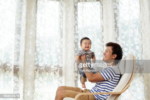 The father who lifts a child in his arms. : Stock Photo