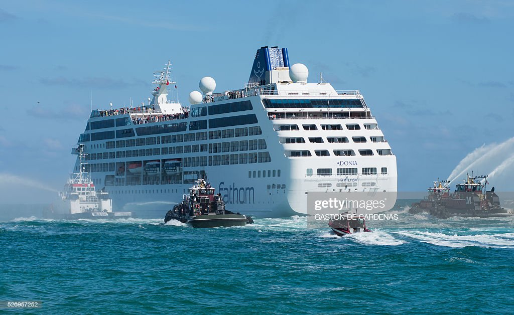 The Fathom cruise ship Adonia departs Miami Beach, Florida with fanfare and water cannons on her inaugural seven-day voyage to Cuba on May 1, 2016. The first US cruise ship bound for Cuba in half a century set sail from Florida on Sunday, May 1st, marking a new milestone in the rapprochement between Washington and Havan / AFP / Gaston De Cardenas