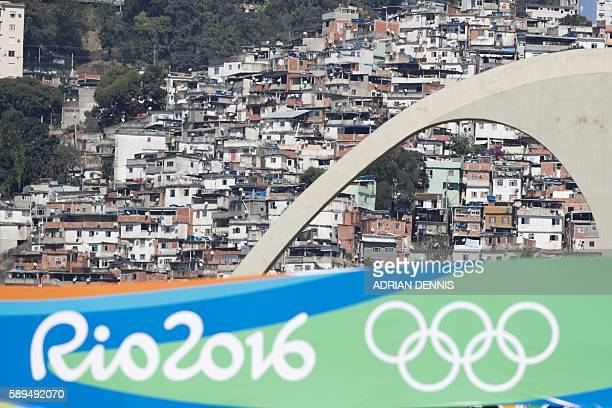 The favela San Carlos is pictured from the finish area of the Women's Marathon during the athletics event at the Rio 2016 Olympic Games at Sambodromo...