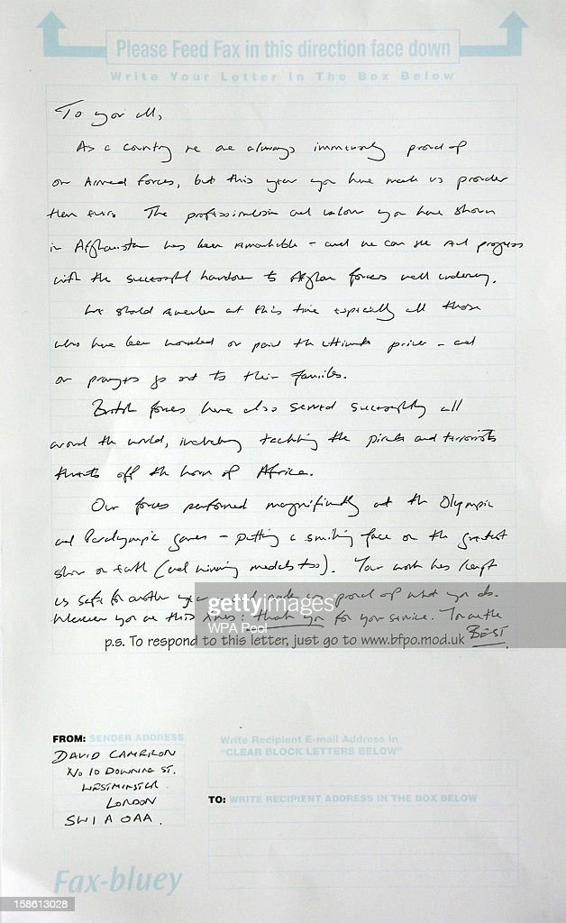 The 'Fax Bluey' message to all of the bases in Afghanistan written by Britain's Prime Minister David Cameron is displayed in the post office at Camp...