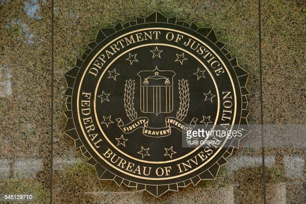 The FBI seal is seen outside the headquarters building in Washington DC on July 5 2016 The FBI said Tuesday it will not recommend charges over...