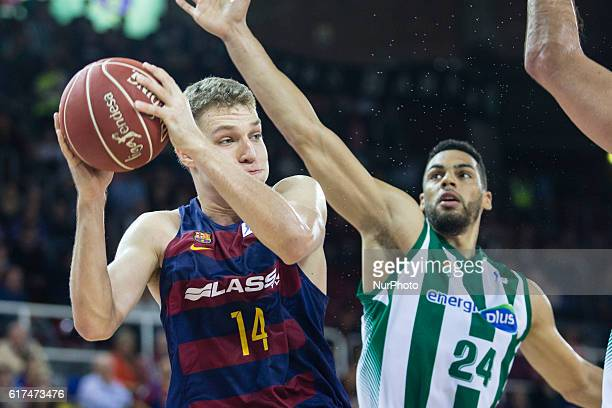 The FC Barcelona player Aleksandar Venzekov from Xipre defensed by f24 The Real Betis player Trent Lockett from United States in action during the...