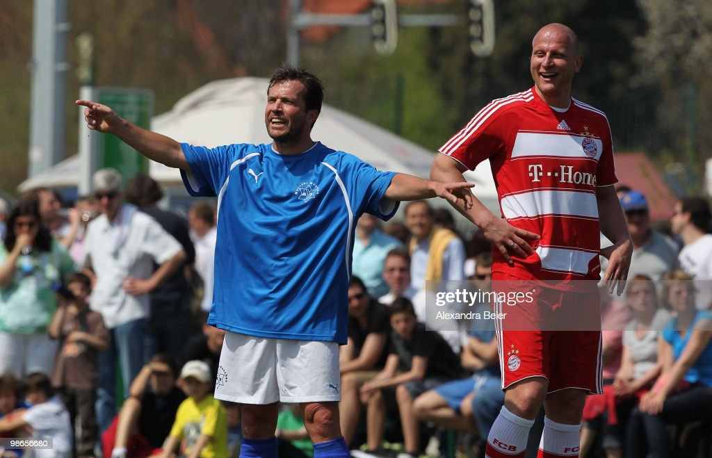 The FC Bayern Muenchen All Star soccer player Carsten Jancker laughs as Maccabi Muenchen player Lothar Matthaeus jokes during a friendly match at the...