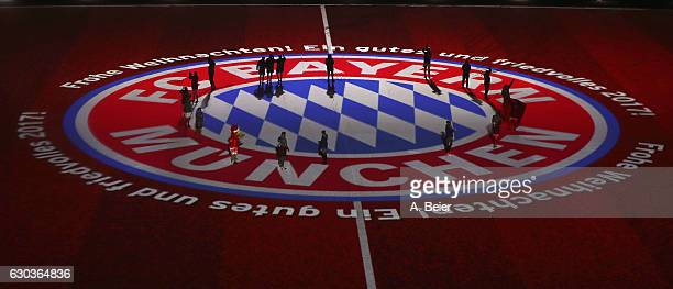 The FC Bayern Muenchen players are pictured on a huge logo during a projection show after the Bundesliga match between Bayern Muenchen and RB Leipzig...
