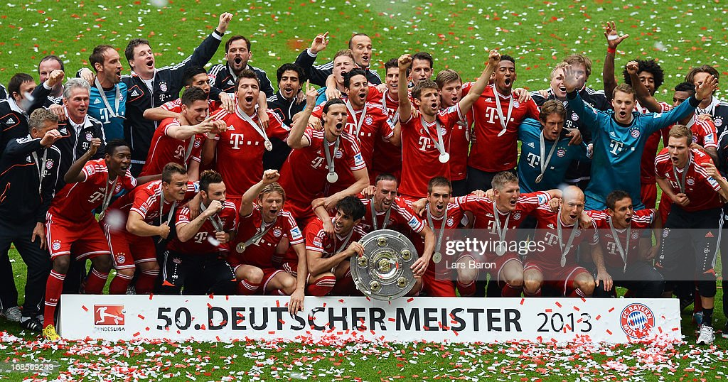 The FC Bayern Muenchen players celebrate with the Bundesliga trophy following their match against Augsburg at the Allianz Arena on May 11, 2013 in Munich, Germany.